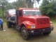 1995 International flat bed tow truck 20ft bed able to carry anything that fits on the bed!! In good condition. Call 1 809 995 6966